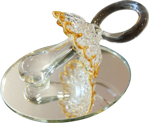 Tétine ciselée en verre sur miroir